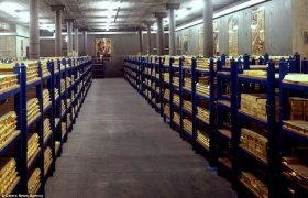 Rich pickings: The rows of simple shelves are stacked high with 28lb 24-carat gold bars
